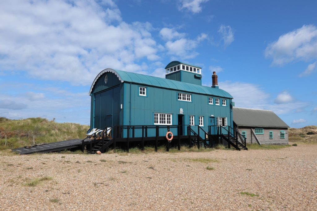 The iconic Lifeboat House at Blakeney Point on a sunny day.