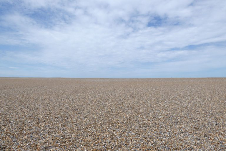 The vast empty pebble beach at Salthouse.