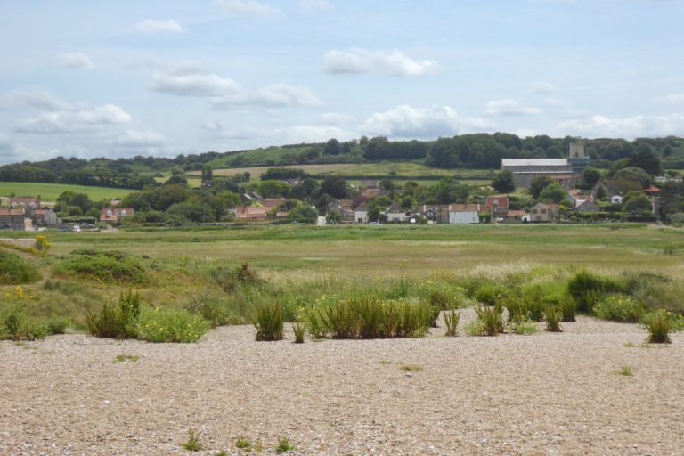 The view of Salthouse church and village from the beach.