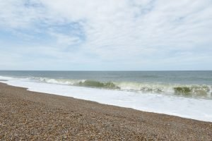 Rolling waves on the pebble beach at Salthouse.