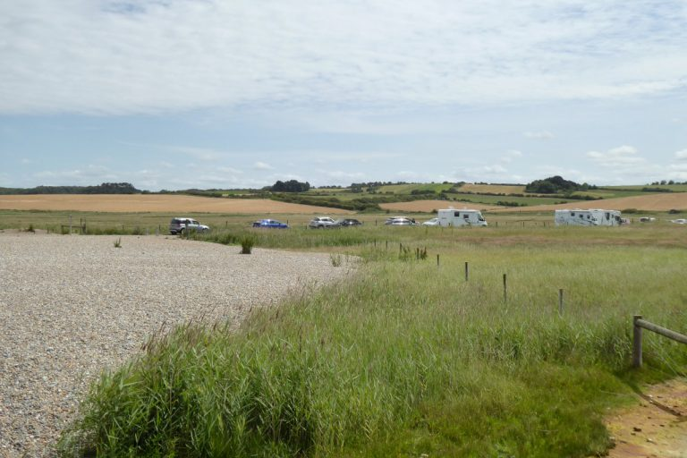 The car park and surrounding fields at Salthouse beach.