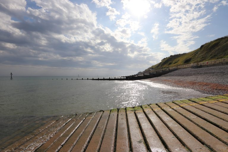 View across the sea towards Sheringham from the slipway.