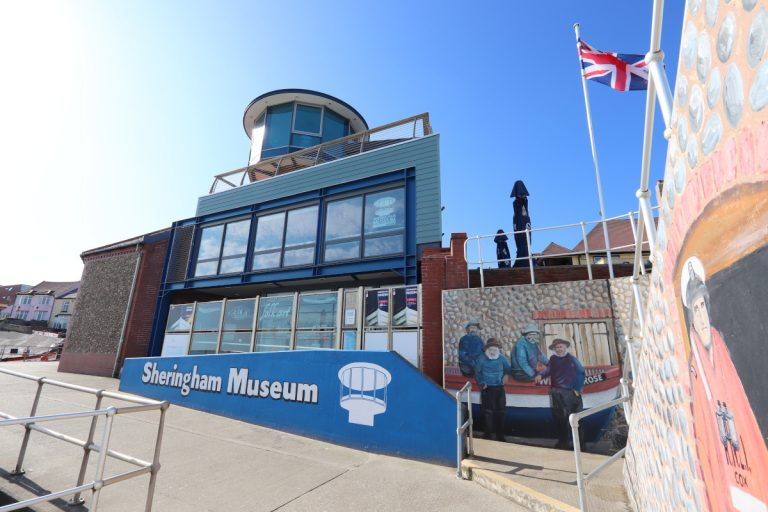 Sheringham Museum and painted murals on the town walls.