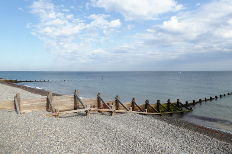 A wooden groyne on the pebble beach at Sheringham.