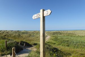 Signpost pointing to Seahenge site at Thornham beach.