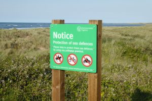 A Protection of Sea Defences Notice at Thornham Beach.