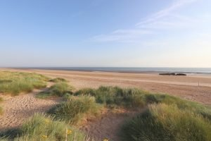 Grassy dunes and an empty beach at Titchwell.