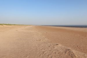 The deserted sandy beach at Titchwell in Norfolk.