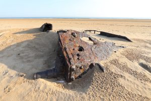 The remains of military tanks in the sand at Titchwell beach.