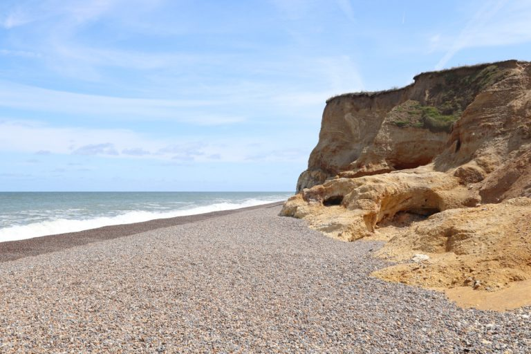 The sandy cliffs and pebble beach at Weybourne.