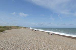 Sunbathers and fishermen at Weybourne beach.