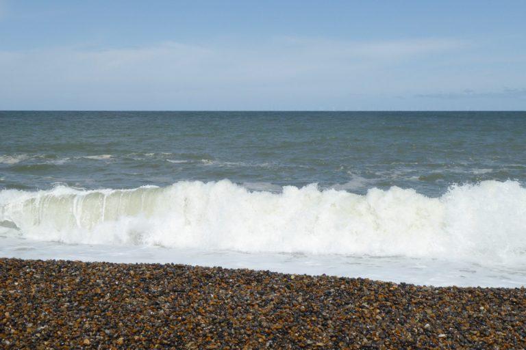 Waves crashing onto the shore at Weybourne beach.