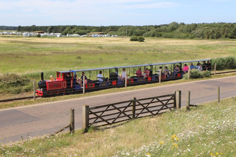 The miniature train at Wells-next-the-Sea travelling from the beach to the town.