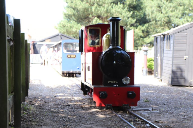 The engine joining the carriages to form the Wells Harbour Railway.