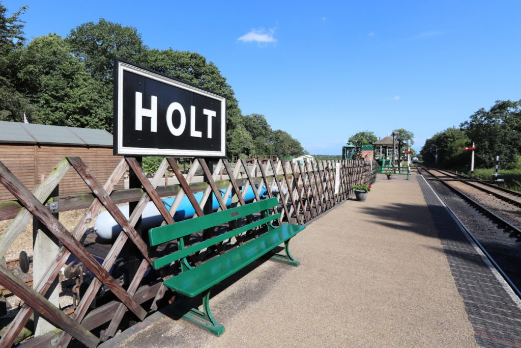 The platform at Holt Station with prominent Holt sign.