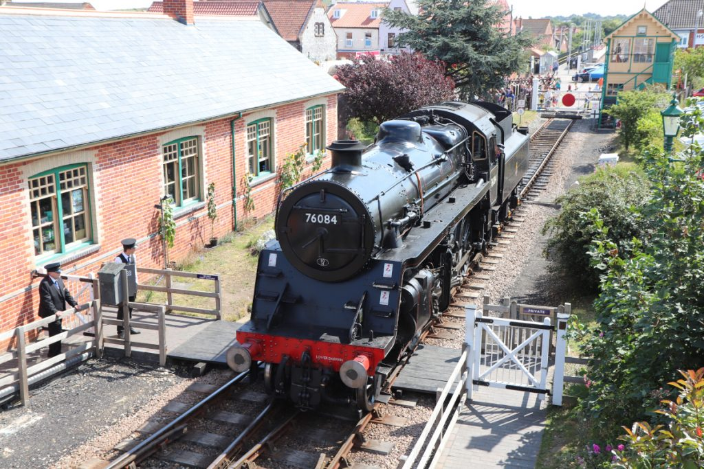 The Poppy Line steam engine on the tracks at Sheringham Station.