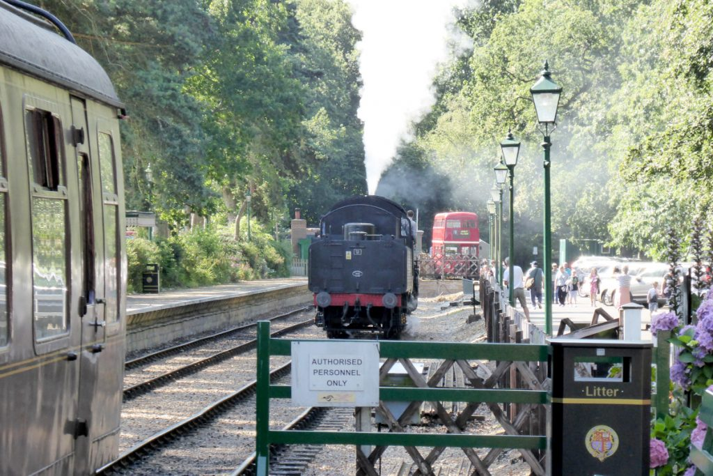 The steam engine changing ends at Holt Station.