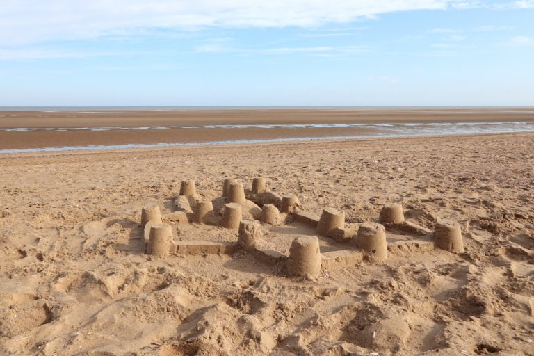 A sandcastle on the empty beach at Old Hunstanton, Norfolk.