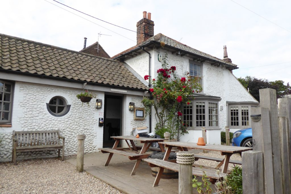The pretty rose-clad exterior of the Anchor Inn pub in Morston.