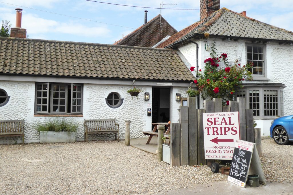 The Anchor Inn pub at Morston displaying signs for Temples Seal Trips.