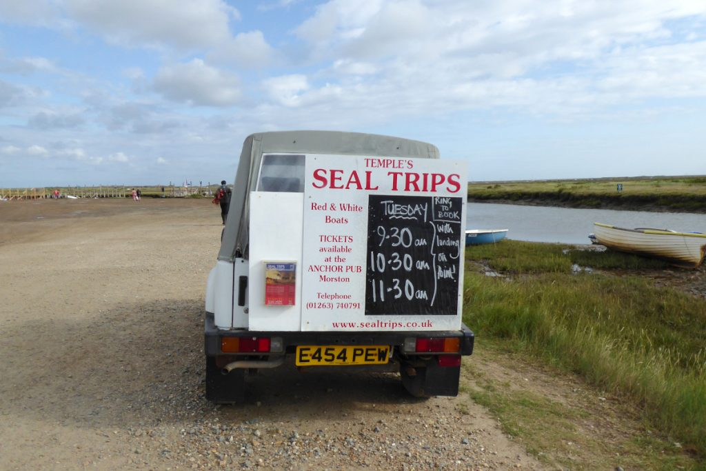 A van at Morston Quay displaying the Temples seal trip departure times.