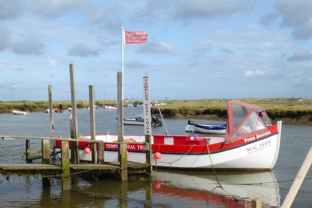 The Four Sisters boat owned by Temples Seal Trips moored at Morston Quay.