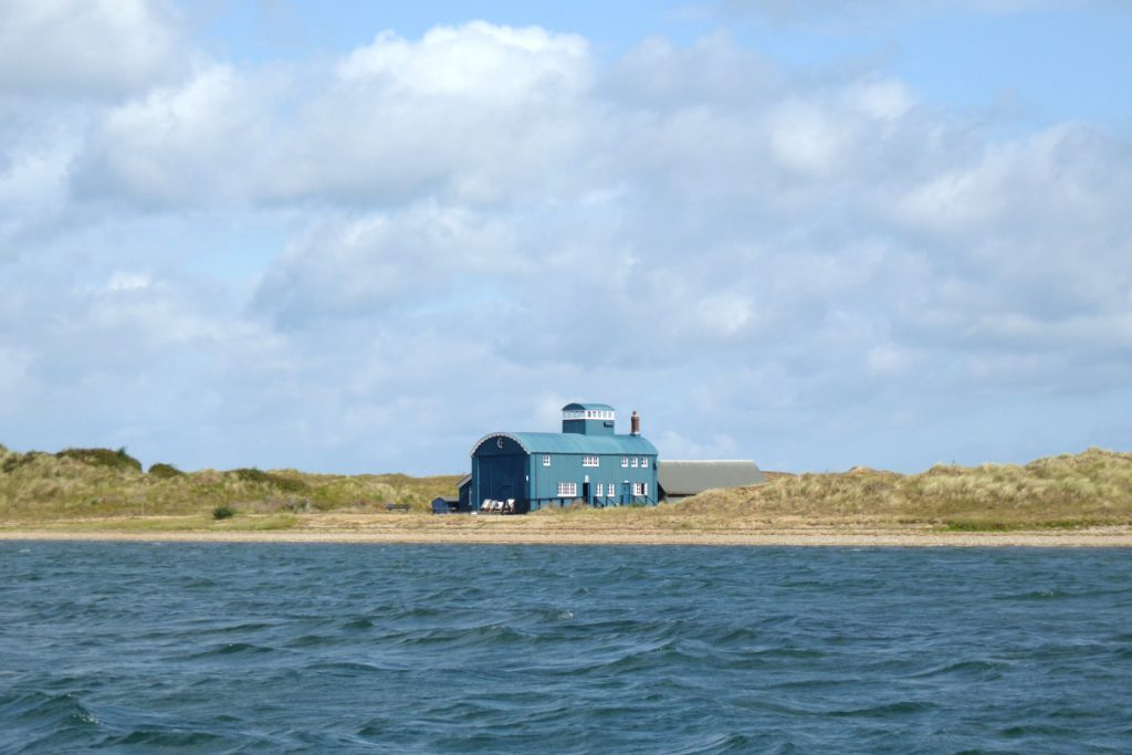 The iconic Lifeboat House at Blakeney Point as seen from the water.