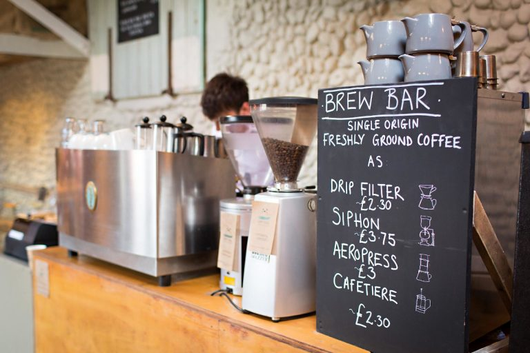 The Brew Bat at Grey Seal Coffee featuring coffee grinders and a menu.