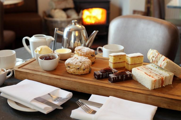 Afternoon tea at The Crown in Wells including fingers sandwiches and scones.
