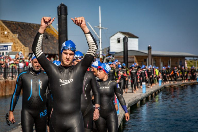 Swimmers lined up on the quay for the North Norfolk Triathlon.