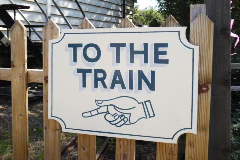 To The Train sign at the Wells light railway station.