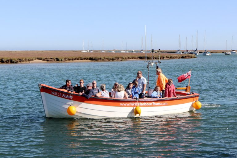Wells Harbour Tours boat ferrying passengers back to town.