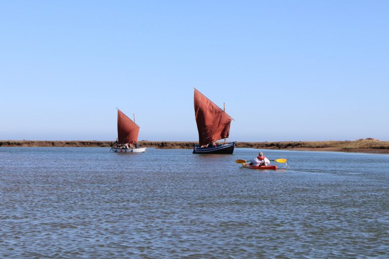 Two traditional fishing boats and a kayak at Wells.