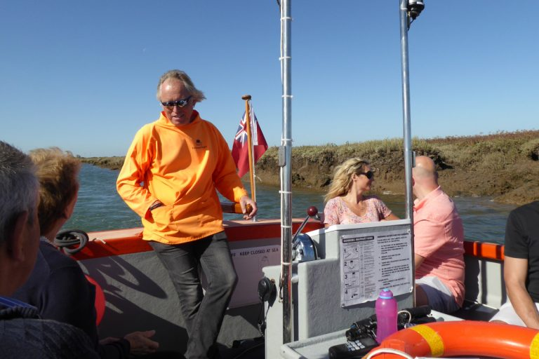 Passengers and skipper during a Wells Harbour Tour.